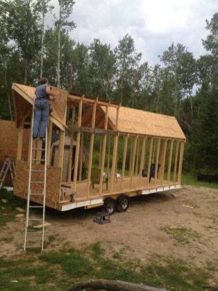 Great pictures of a couple building their own tiny house using a boat trailer (Couple Living Simpl. Ft. Tiny House Built for _15k)