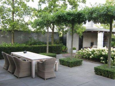 Grey rattan kubu chairs in a Modern Country Garden