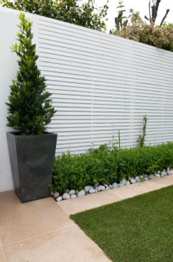 I like the rocks as a border for the garden. Maybe this would work around the trees instead of a fence_