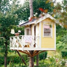 I sort of like this treehouse. Think I would put the tree through the front porch and hold up the house with supp