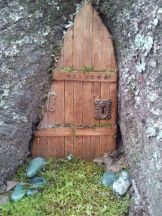 Kristen Womack wrote_ My first fairy door. Made from pine wood_ craft sticks_ stain and miniature door parts. I ca