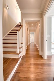 Stairway And Hallway With Black Walnut Floor By Oak & Broad