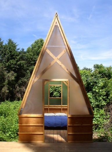 The Swamp Huts have a timber frame and polycarbonate panels (Photo_ Moskow Linn Architects_ from the...