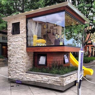 This modern playhouse is too cool. Glass windows_ multiple levels_ and a slide make this space the ultimate luxury hideout. Source_ Instagram user chefomeo (1)
