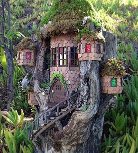 Unique fairy_pixie houses built into fallen logs. Each having it_s own personality and flair.