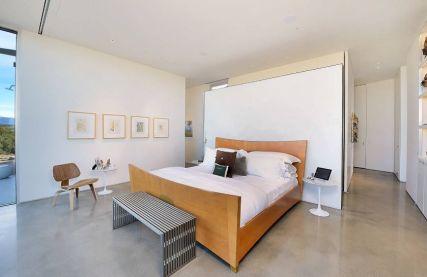 Bedroom-with-concrete-floor-and-minimalist-decor
