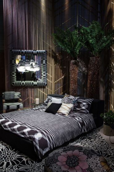 Bedroom-with-dark-accents-and-floral-patterns-for-carpet