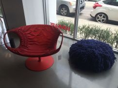 Brick-red-armchair-and-deep-blue-pouf