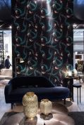 Contemporary-floral-pattern-wallpaper-and-dark-blue-couch