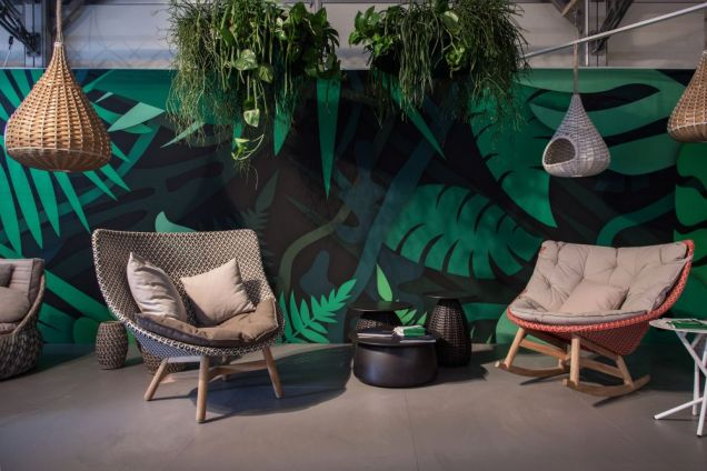 Decorating-an-outdoor-area-wall-with-large-floral-leaf-pattern-in-green