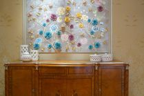 Rococo-furniture-sideboard-with-framed-floral-art-above