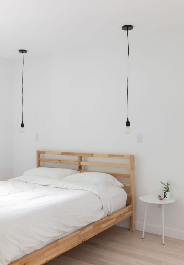 Scandinavian-bedroom-with-wood-frame-and-hanging-cord-light