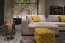Tufted-yellow-ottoman-in-front-of-sofa