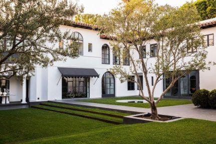 White-spanish-house-with-shunken-garden