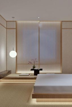 a-Japandi-bedroom-with-a-wooden-screen-low-wooden-furniture-built-in-lights-and-a-tea-zone-feels-very-zen-like