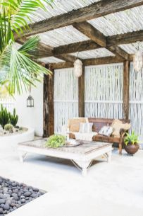 a-beach-terrace-with-vintage-wooden-furniture-Moroccan-lamps-potted-greenery-cacti-and-other-plants-is-very-relaxed