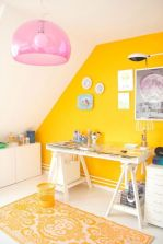 a-bold-and-shiny-craft-room-with-a-sunny-yellow-accent-wall-white-furniture-a-pink-pendant-lamp-and-pretty-artworks