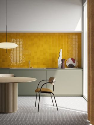 a-bold-modern-kitchen-with-olive-grey-cabinetry-a-yellow-tile-backsplash-and-a-refined-table-and-chairs-is-wow