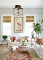 a-bright-and-cool-living-room-with-white-furniture-greenery-and-neutral-blooms-a-boho-rug-and-printed-curtains-a-bold-artwork