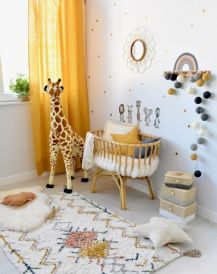 a-bright-and-cool-nursery-with-a-polka-dot-wall-bright-rugs-a-crib-with-pillows-some-toys-and-touches-of-yellow