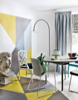 a-bright-dining-room-done-with-geometric-color-blocj-grey-and-white-chairs-a-modern-table-and-a-catchy-floor-lamp