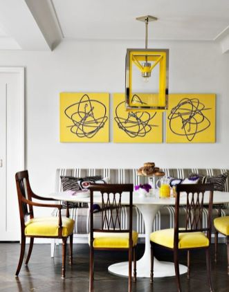 a-bright-dining-room-with-a-vintage-feel-a-bold-yellow-gallery-wall-a-grey-striped-sofa-yellow-chairs-and-a-catchy-pendant-lamp