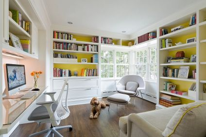 a-bright-home-office-with-mustard-walls-and-built-in-shelves-a-built-in-desk-a-grey-chair-a-lovely-creamy-one-and-a-grey-and-yellow-sofa