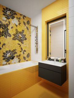 a-bright-modern-bathroom-with-yellow-tiles-a-floral-tile-wall-and-a-grey-vanity-plus-lights-for-an-accent