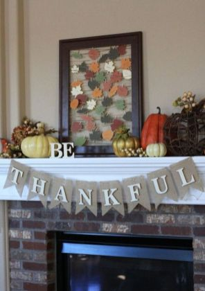 a-bright-vintage-Thanksgiving-mantel-with-bold-pumpkins-berries-and-string-art-with-colorful-paper-leaves