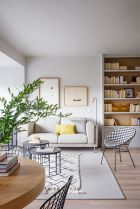 a-chic-and-neutral-living-room-accessorized-with-yellow-pillows-and-greenery-to-make-it-feel-like-spring
