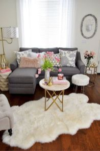 a-chic-spring-living-room-with-gold-touches-neutral-textiles-pink-blooms-and-accents-is-a-romantic-and-chic-space