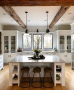 a-clean-white-kitchen-with-rough-wooden-beams-that-add-warmth-and-coziness-to-the-space-and-make-it-catchy