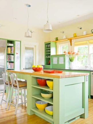 a-colorful-green-kitchen-with-a-matching-kitchen-island-butcherblock-countertops-red-and-yellow-accessories-and-touches
