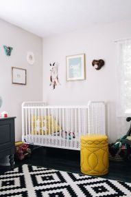 a-contrasting-nursery-in-black-and-white-with-black-and-white-furniture-yellow-touches-and-a-pretty-gallery-wall