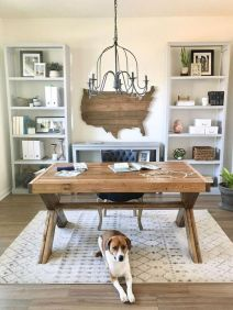 a-cozy-farmhouse-home-office-with-storage-units-a-wooden-desk-a-state-wal-art-a-printed-rug-and-a-vintage-chandelier