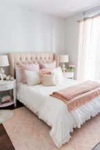 a-cute-and-sweet-feminine-bedroom-with-grey-walls-a-neutral-bed-with-pink-ruffled-bedding-a-pink-rug-and-white-nightstands