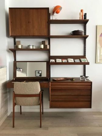 a-dark-stained-storage-wall-unit-with-open-shelves-and-cabinets-plus-a-desk-with-a-mirror-under-it-is-a-cool-option-for-a-mid-century-modern-space