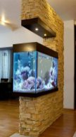 a-faux-stone-wall-with-a-built-in-aquarium-and-lights-is-a-bold-modern-space-divider-to-go-for