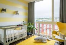 a-funny-nursery-with-a-striped-yellow-wall-rug-and-a-chair-grey-and-white-furniture-and-faux-taxidermy