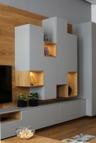 a-gorgeous-sleek-grey-and-light-stained-wood-wall-storage-unit-with-closed-and-open-storage-compartments-is-a-very-cool-idea
