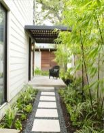 a-low-maintenance-front-yard-with-pebbles-tiles-greenery-and-bamboo-is-a-lovely-idea-for-a-modern-home