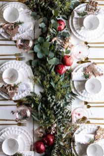 a-lush-greenery-runner-and-some-ripe-pomegranates-will-make-your-tablescape-ultimately-fall-chic-and-Thanksgiving-ready