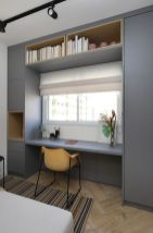 a-minimalist-home-office-nook-with-a-built-in-storage-unit-a-window-for-a-view-a-small-yellow-chair-is-all-you-need-for-work