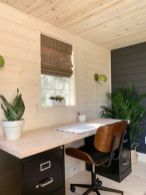 a-modern-farmhouse-home-office-with-the-walls-ceiling-and-floor-clad-with-wood-a-contrasting-desk-and-potted-greenery