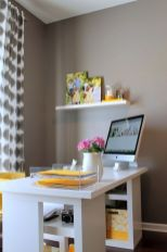a-modern-home-office-with-grey-walls-a-white-desk-with-yellow-touches-and-a-yellow-chair-printed-grey-curtains-is-simple-and-cool
