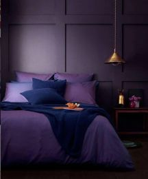 a-moody-monochromatic-bedroom-with-deep-purple-paneled-walls-purple-and-navy-bedding-a-wooden-nightstand-and-a-metal-pendant-lamp