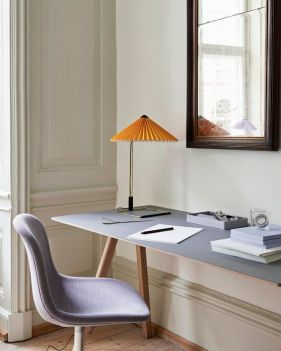 a-neutral-sophisticated-home-office-with-a-grey-trestle-desk-a-grey-chair-and-a-yellow-lamp-with-a-pleated-shade