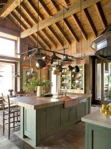 a-rustic-kitchen-with-green-cabinetry-wooden-and-stone-countertops-a-wooden-ceiling-with-beams-is-a-chic-space