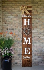 a-rustic-spring-sign-of-a-stained-piece-of-wood-with-a-blooming-wreath-a-burlap-ribbon-and-some-letters