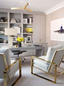 a-sophisticated-home-office-in-dove-grey-with-built-in-storage-units-a-sleek-grey-desk-and-gold-and-grey-chairs-plus-yellow-touches